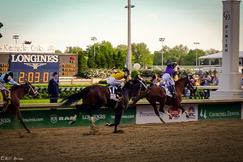 California Chrome crosses the finish line in the 2014 Kentucky Derby.
