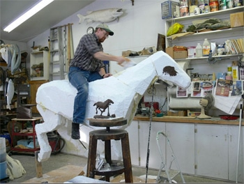carving styrofoam core for horse sculpture