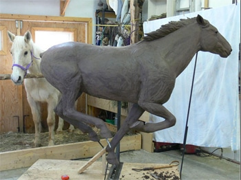 sculpting a clay horse